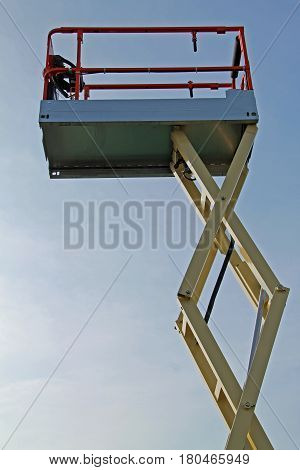 The Lifting Arm and Platform Cage of a Hydraulic Lift.