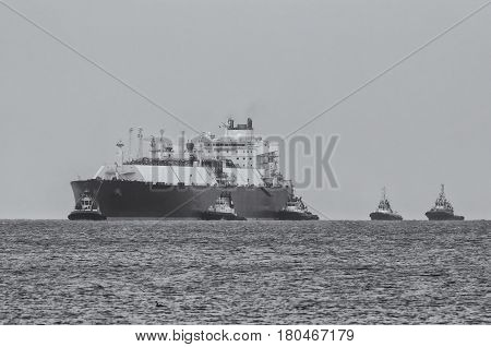LNG TANKER AT SEA - Gas carrier at sea escorted by tugs
