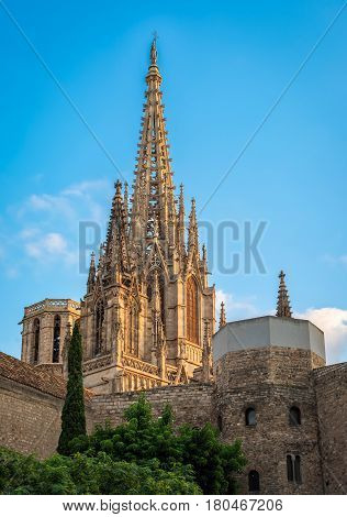 Spire of Cathedral of the Holy Cross and Saint Eulalia in Barcelona Spain at sunset. Copy space in blue sky.