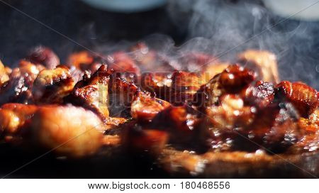 Hot cook meat in smoke fry on cauldron pan. Delicious food meat and seasonings. The first stage of cooking pilaf