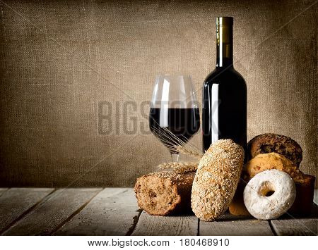 Wine and assortment of bread on the wooden table