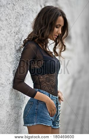 Girls in short denim shorts and a dark blouse