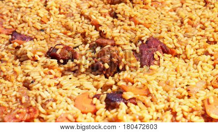 Pilaf cooked. Delicious food meat rice vegetable and seasonings