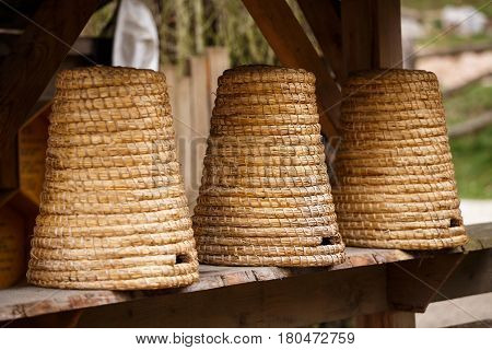 Three old beehives of straw. Old beehives.