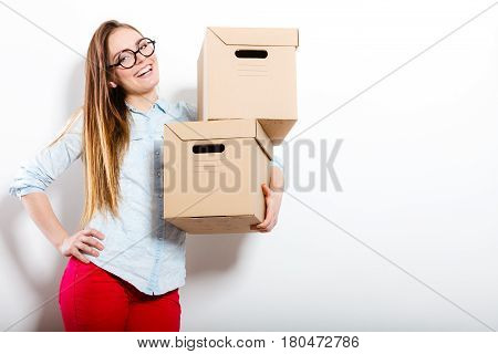 Happy Woman Moving Into House Carrying Boxes.