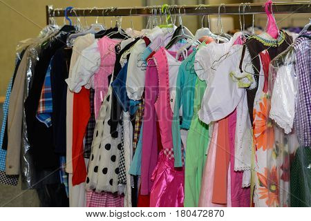 Bright colorful selection of children's wear at a bazaar - close-up