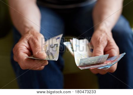 Close Up Hands Of Old Woman Counting Money