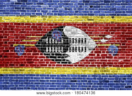 Flag of Swaziland painted on brick wall, background texture