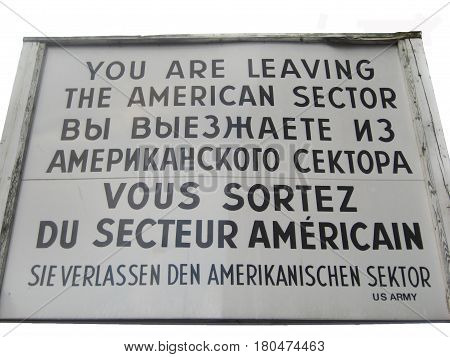 BERLIN, GERMANY - JULY 20, 2016: Famous historical  sign at former East West Berlin border. Former Checkpoint Charlie, old sign with warning of leaving the american sector