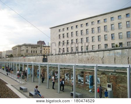 BERLIN, GERMANY - JULY 20, 2016: People visiting Topography of Terror outdoor museum, Berlin 1933 - 1945 between terror and propaganda. Nazi regime history exhibition, former Gestapo and the SS headquarters in Berlin, Germany