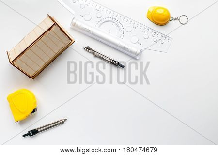 profession concept with architect desk and constructor tools on white background top view mock-up