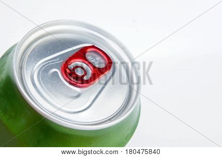 aluminum green soda can canned on white background