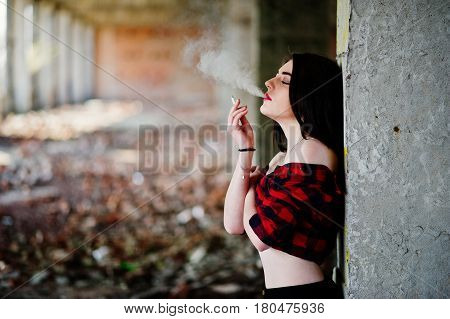 Portrait Smoking Girl With Red Lips Wearing A Red Checkered Shirt With Bare Shoulders Posed Sexy Bac