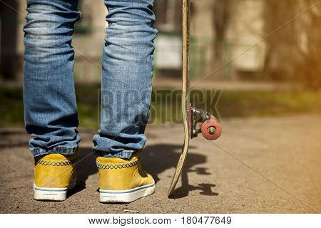 young skateboarders legs skateboarding at skatepark outdoors