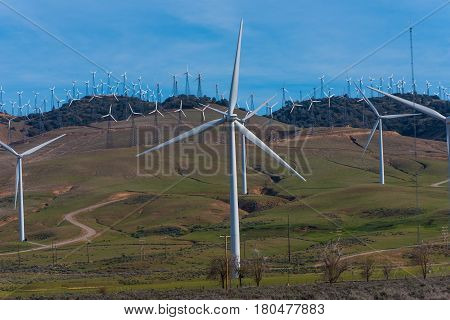 Many Windmills On A Hill With Road