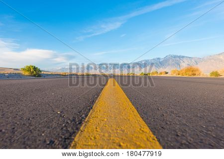 Yellow Line In Middle Of Road In Desert