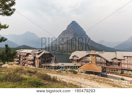 View Of Buildings And Mountains At Many Glacier Hotel