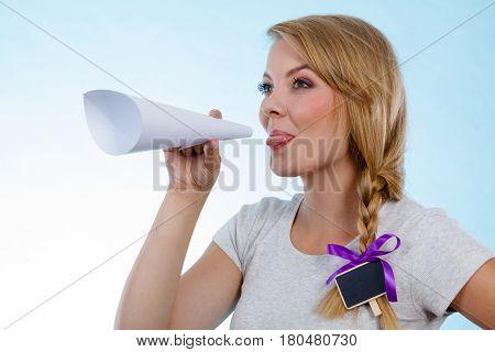 Woman Screaming Through Megaphone Made Of Paper
