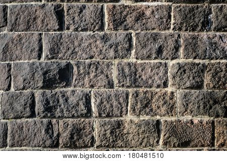 Background of stone wall texture photo with a brick