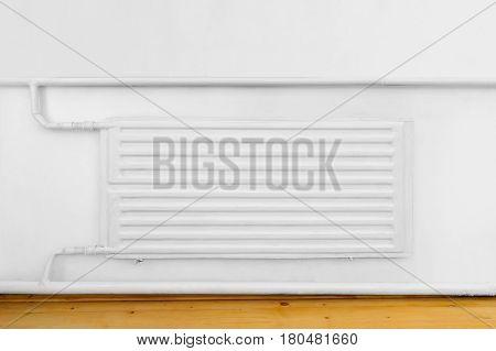 Radiator in apartment, interior white, concept background