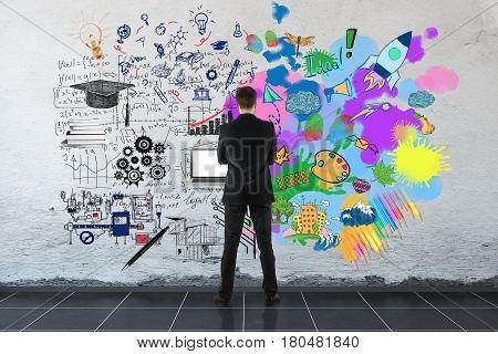 Creative and analytical thinking concept. Back view of businessman looking at concrete wall with colorful sketch and formulas. 3D Rendering