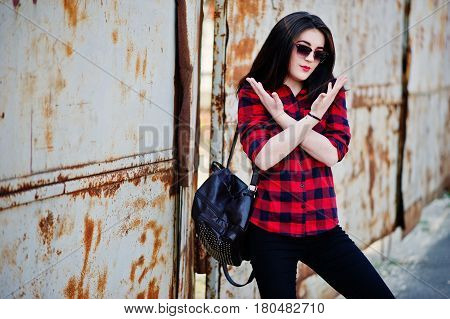 Fashion Portrait Girl With Red Lips Wearing A Red Checkered Shirt, Sunglasses And Backpack Backgroun