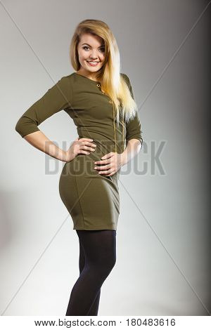 Attractive Blonde Woman Wearing Tight Green Khaki Dress