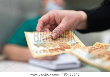 The doctor takes money from the patient .