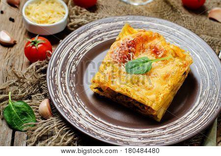 Chicken sweet potato spinach lasagna on wood background