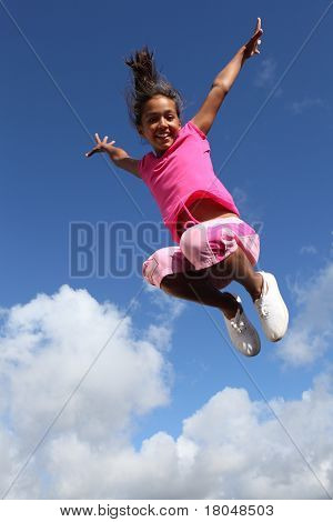 Happy leap of joy great success for young girl