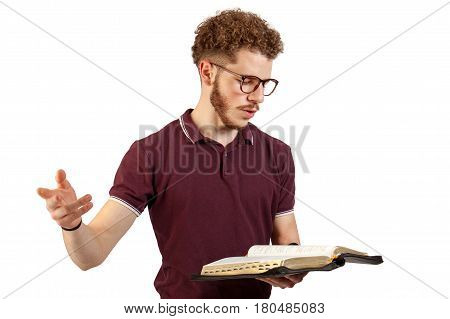 Young man reading from the Bible on white background
