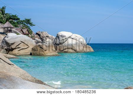 Blue tranquil sea and boulders beach Haad Yuan at Koh Phangan, Thailand, Asia
