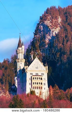Neuschwanstein Castle the famous castle in Germany, Bavaria, mountains and blue sky