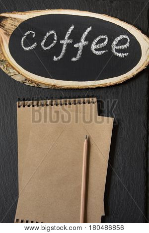 Nameplate from a birch board with the text 'Coffee' on a chalkboard. Image with space for your text, recipe or menu.
