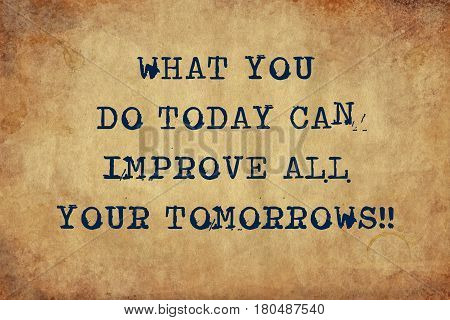 Inspiring motivation quote with typewriter text what you do today can improve all your tomorrows. Distressed Old Paper with Typing image.
