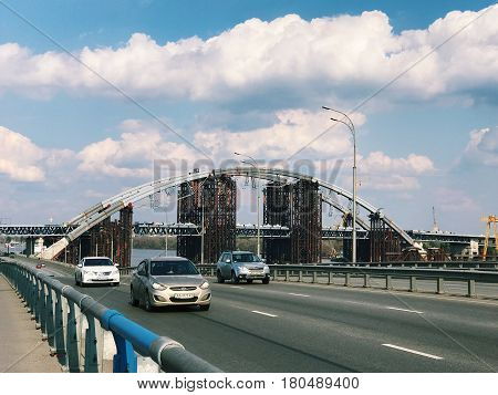Kiev, Ukraine - April 04, 2017: Traffic in a big city on a bridge cityscape