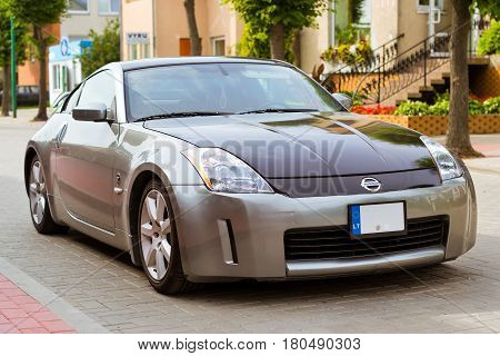 Palanga Lithuania - August 13 2012: Modern sports coupe car Nissan 350z parked on main transport highway in Lithuanian resort town Palanga. Youth high-tech sports car of Japanese production