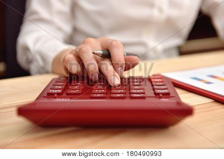 Businesswoman Hand Using  Calculator