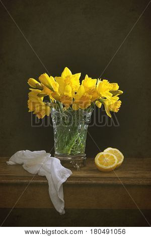 Bunch of Spring daffodil flowers still life with lemons