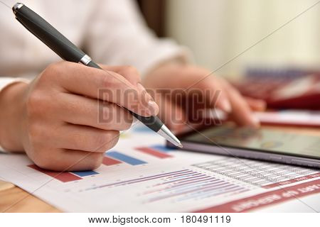 Hand Using Mobile Phone With Financial Data
