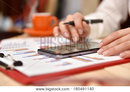 Hand Analyzing Income Data