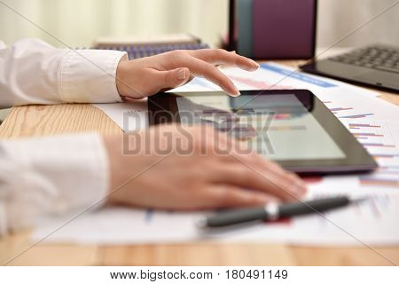 Hand Touching Tablet With Graph