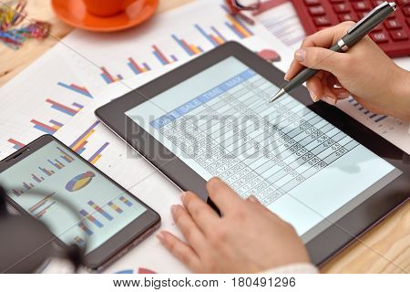 Businesswoman Hand Analyzing Income Data
