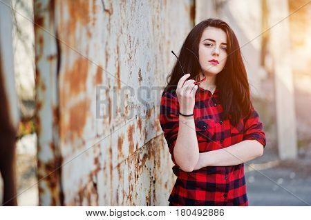 Fashion Portrait Girl With Red Lips Wearing A Red Checkered Shirt And Sunglasses Background Rusty Fe