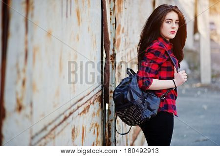 Fashion Portrait Girl With Red Lips Wearing A Red Checkered Shirt And Backpack Background Rusty Fenc