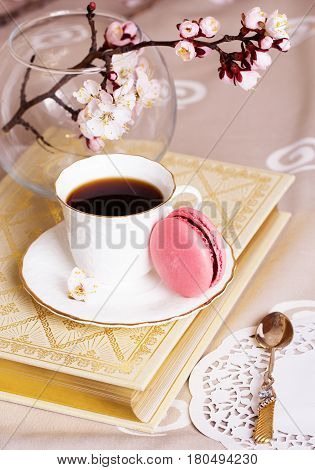A french sweet delicacy macaroons variety . macaroon and cup of coffee on turquoise vintage table for cozy breakfast.