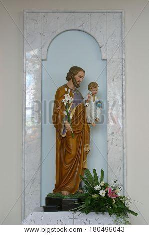 LASINJA, CROATIA - JUNE 21: Saint Joseph holding baby Jesus, Parish Church of Saint Anthony of Padua in Lasinja, Croatia on June 21, 2011.