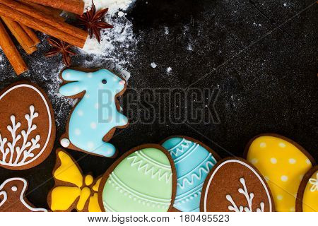 Cooking easter cookies - flour, spices and eegs and rabbit cookies with copy space
