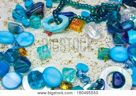 Multicolor glass beads border edge corner with place for text. Nice blue dark blue and yellow beads on crochet background
