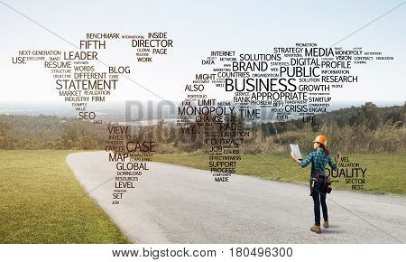 Female construction worker on road and globalisation concept